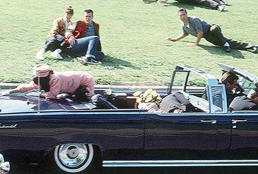 an essay on the assassination of john f kennedy The assassination of president john f kennedy has raised many theories about what exactly happened that day in the fall of 1963 many wonder if the lone gunmen theory published by the warren commission is the truth, or better yet was even possible.